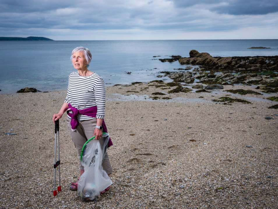 Action Nan on beach with litter picker and recycling bag.jpg