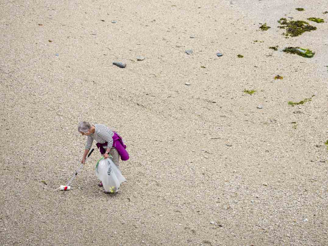 Aerial shot of Action Nan collecting litter on beach.jpg