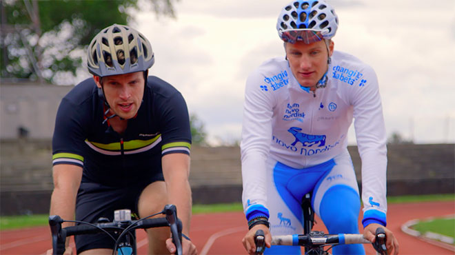 Two men cycling around a track
