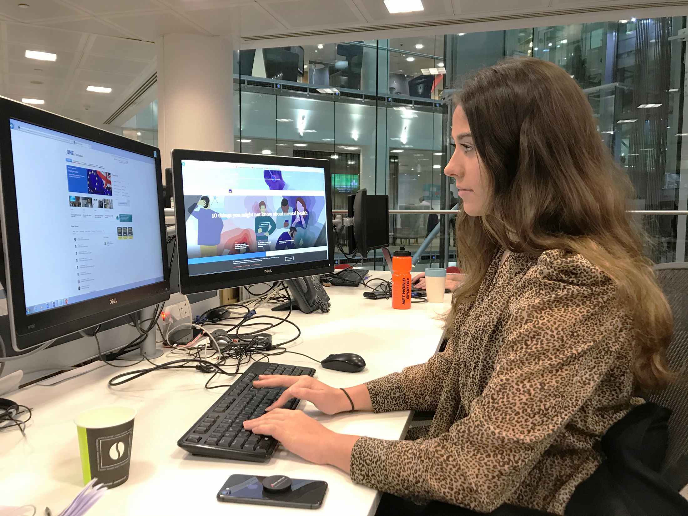 Mia Simpson, PR Apprentice, sat at her desk in AXA's London Office on Old Broad Street