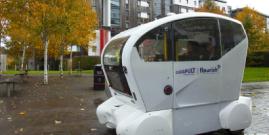 Image of FLOURISH driverless pod outside a building
