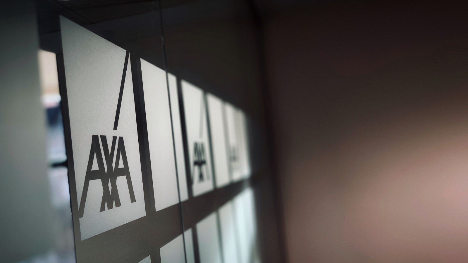 AXA logos etched on glass
