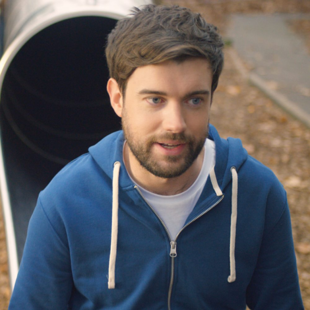 Jack Whitehall at the foot of a play slide
