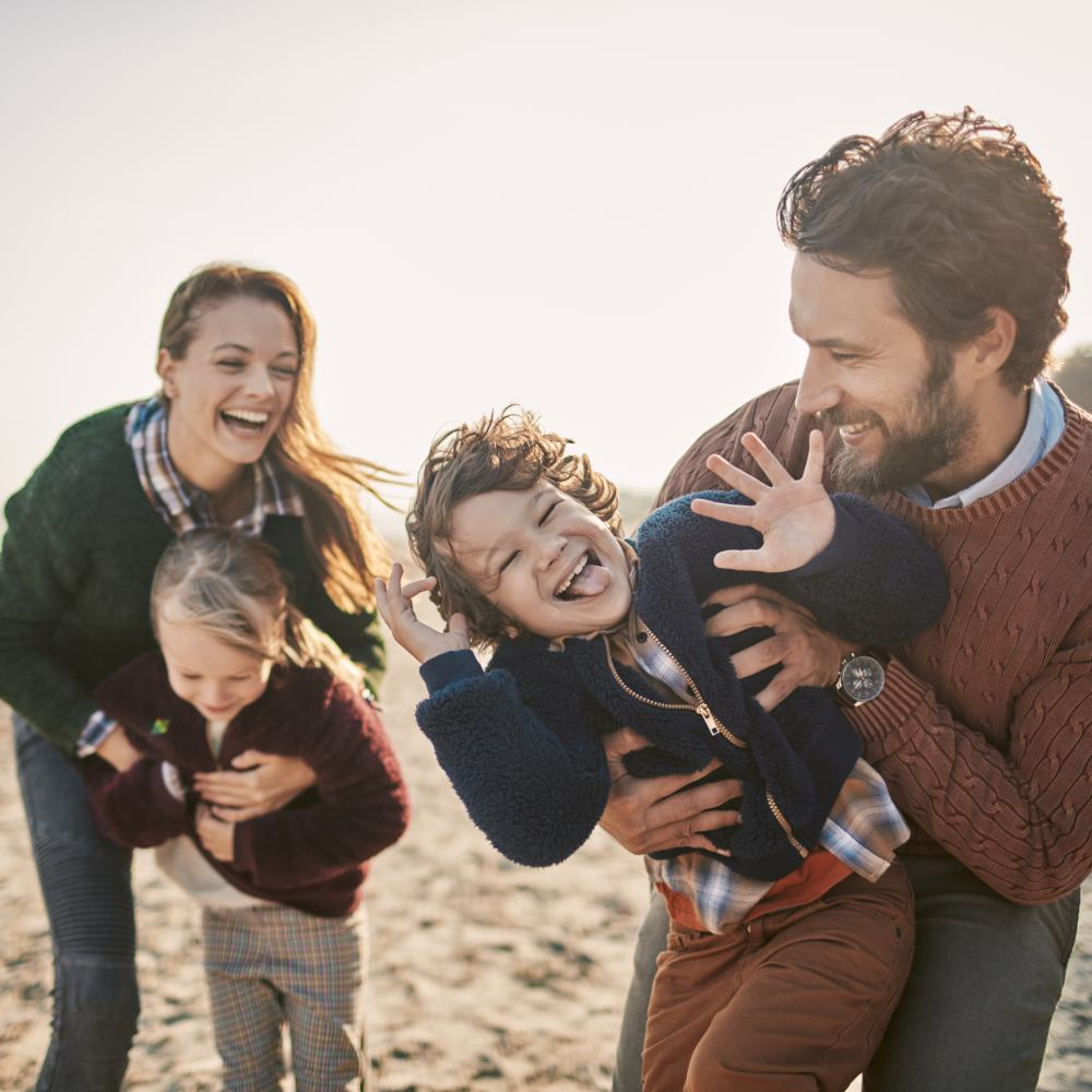 Close up of a happy family enjoying time on the beach