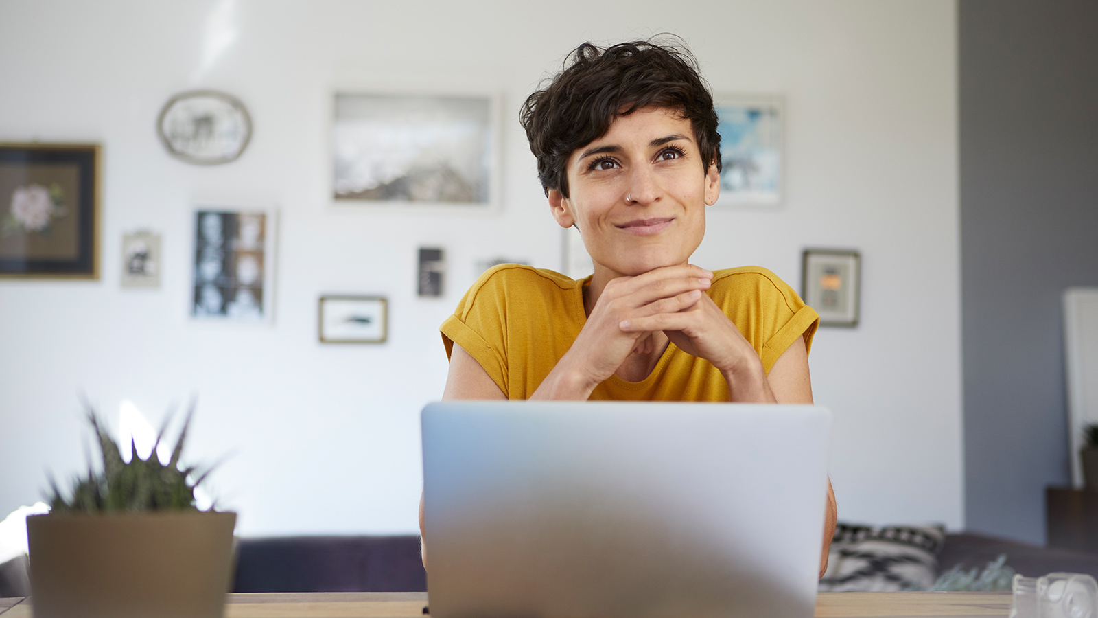 A consultant looks up from her laptop.
