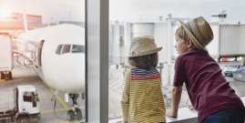 Image of children looking at plane in airport